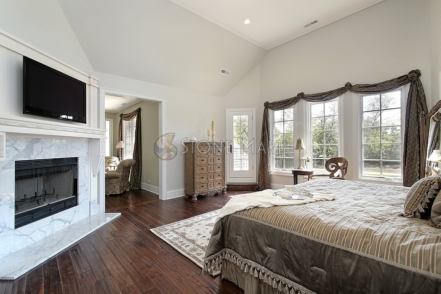 white marble fireplace surround in master bedroom