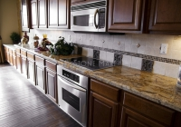 Contemporary Kitchen with Gold Rusty Granite Countertops