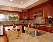 Contemporary Kitchen with Yellow Granite Countertops
