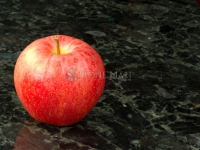 Red Apple on Black and Blue Granite Countertop