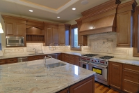 Kitchen with Gold Granite Countertops