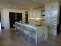 Modern Kitchen with Paonazzo Marble Countertops and Silver Tusk Marble Flooring
