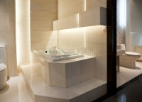 Luxury Master Bathroom with Beige Marble Tub Surround